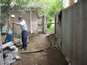Step 2 of Site Prep, our worker installs a solid base to lay the flagstone walkway on Troy, MI