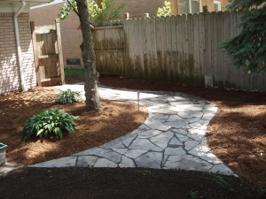 The final flagstone walkway with new double shredded hardwood mulch view 1 Troy, MI