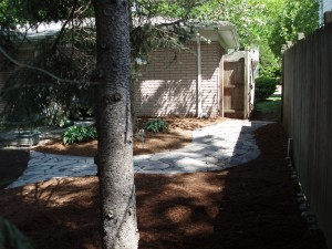 The final flagstone walkway with new double shredded hardwood mulch view 2 Troy, MI
